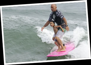 Jack Surfing with his Son Finn